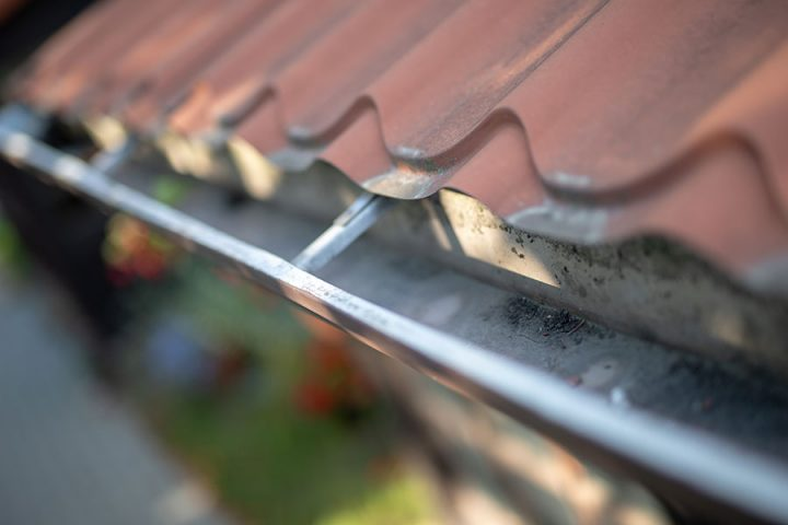 Gutter draining rainwater. The building is equipped with means of draining rainwater away from the roof.
