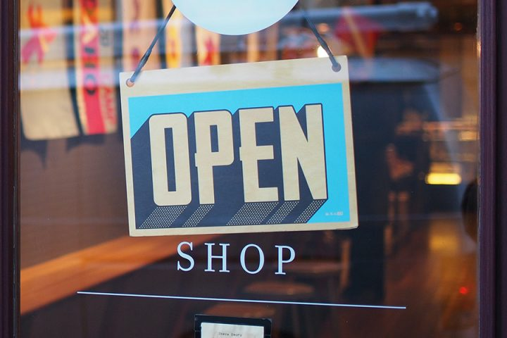 'Open' sign on the front of a shop