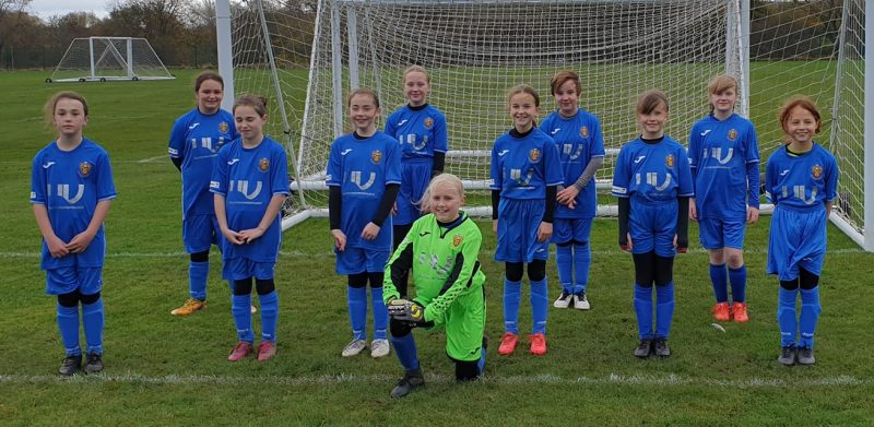 Richmond Town FC U11 girls' team in their new kits, which have been sponsored by UK Gutter Maintenance Ltd.