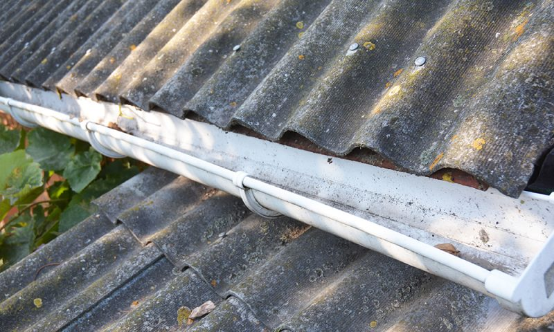 National gutter cleaning: A close-up of a double roof with a clean plastic gutter