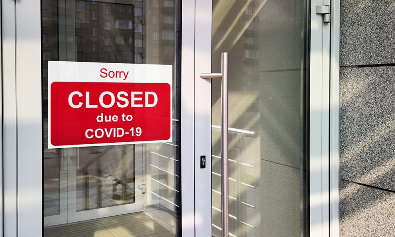 Business centre closed due to COVID-19, sign with sorry in door